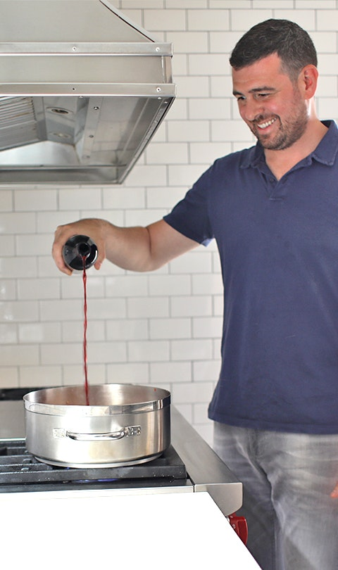 Billy Parisi deglazing a pasta sauce pan with red wine