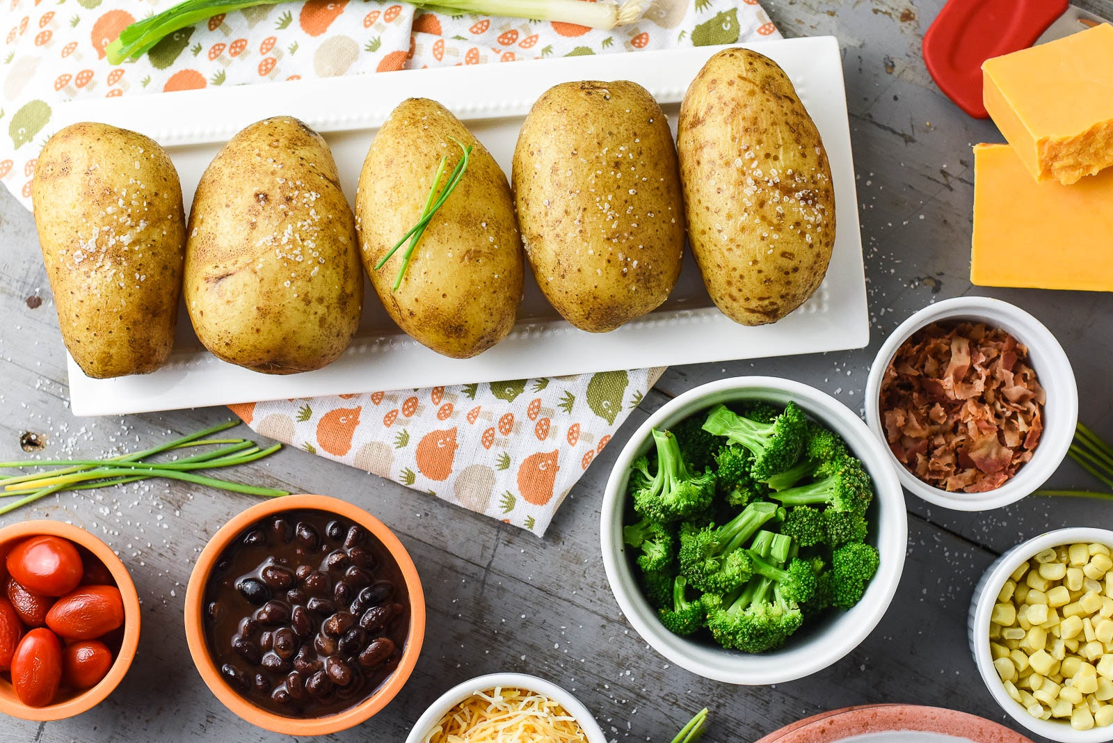 A Kid-Friendly Baked Potato Bar with Slow Cooker Baked Potatoes