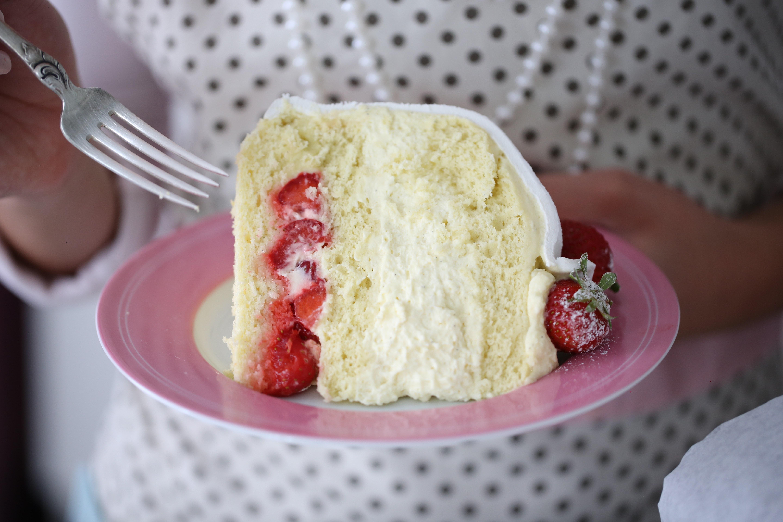 Eating a piece of White Strawberry Swedish Princess Cake