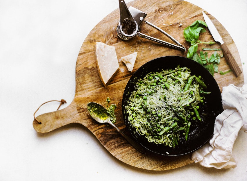 Spinach Noodle Pasta with Fresh Asparagus, Peas, Pesto and Parmesan Cheese