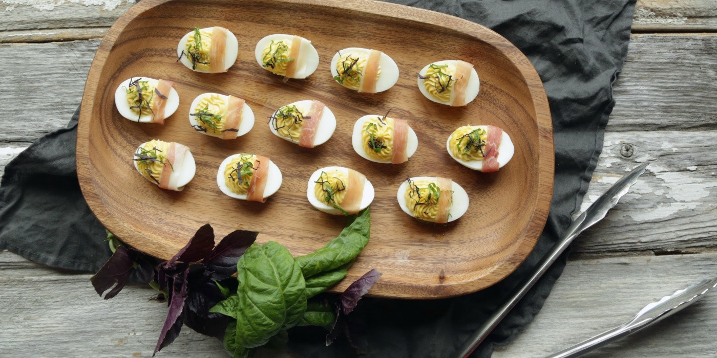 ​Roasted Garlic Deviled Eggs with Prosciutto & Basil